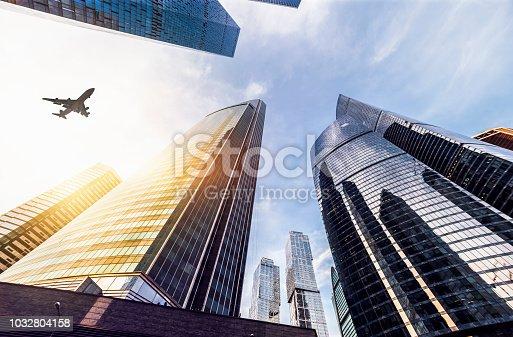 182061540 istock photo Skyscraper with a airplane silhouette 1032804158