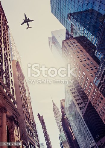 182061540 istock photo Skyscraper with a airplane silhouette 1074173926