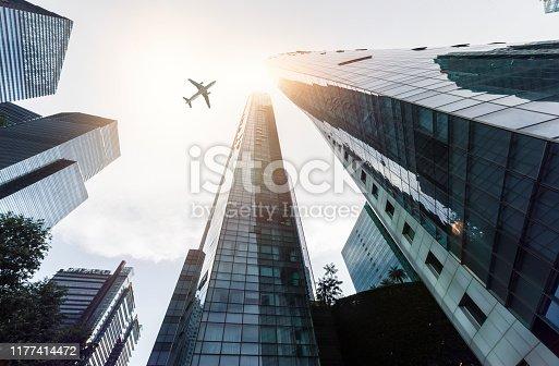 182061540 istock photo Skyscraper with a airplane silhouette 1177414472
