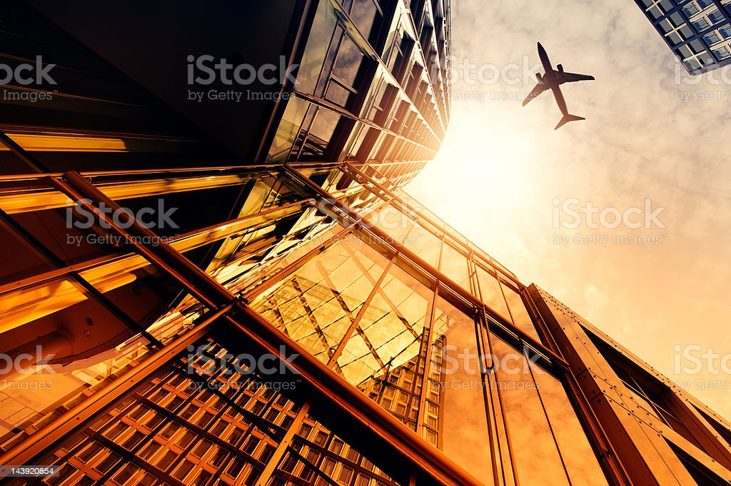 Skyscraper with a airplane silhouette royalty-free stock photo