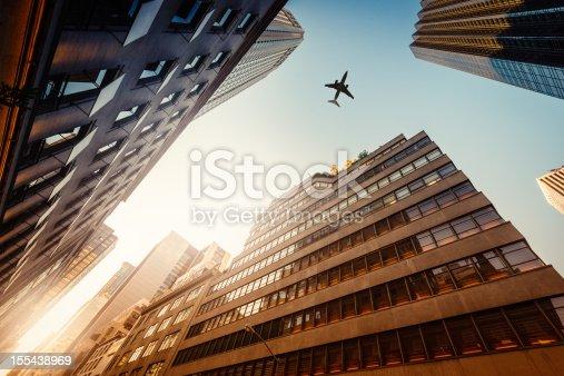 182061540 istock photo Skyscraper with a airplane silhouette 155438969