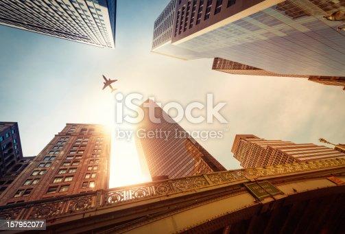 182061540 istock photo Skyscraper with a airplane silhouette 157952077