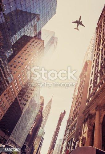 182061540 istock photo Skyscraper with a airplane silhouette 168507382