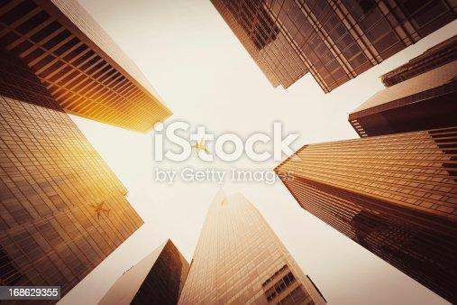 182061540 istock photo Skyscraper with a airplane silhouette 168629355