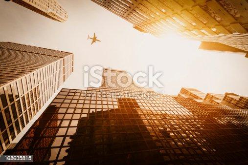 182061540 istock photo Skyscraper with a airplane silhouette 168635815