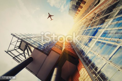 istock Skyscraper with a airplane silhouette 171576798