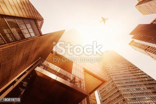 182061540 istock photo Skyscraper with a airplane silhouette 180819713