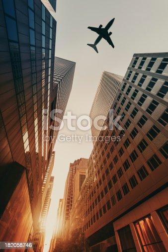 182061540 istock photo Skyscraper with a airplane silhouette 182058746
