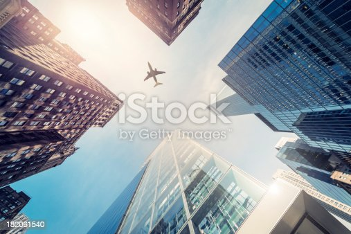 istock Skyscraper with a airplane silhouette 182061540
