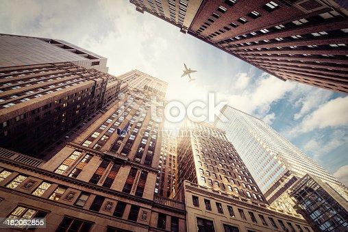 182061540 istock photo Skyscraper with a airplane silhouette 182062855