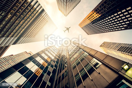 istock Skyscraper with a airplane silhouette 523875700