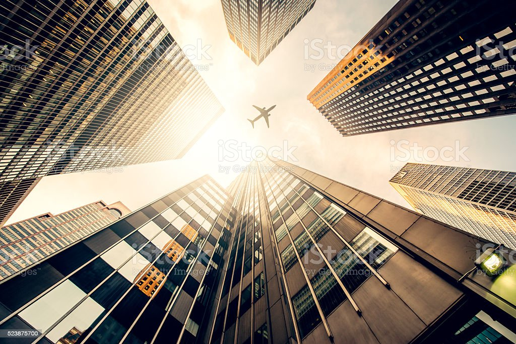 Skyscraper with a airplane silhouette stock photo