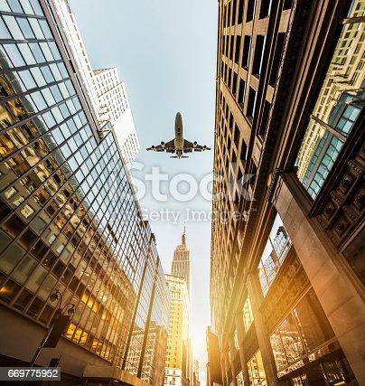 182061540 istock photo Skyscraper with a airplane silhouette 669775952