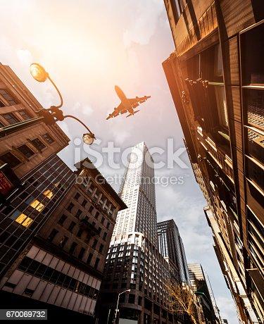 182061540 istock photo Skyscraper with a airplane silhouette 670069732