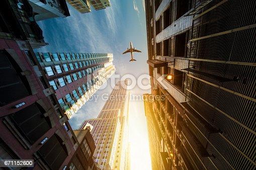 182061540 istock photo Skyscraper with a airplane silhouette 671152600