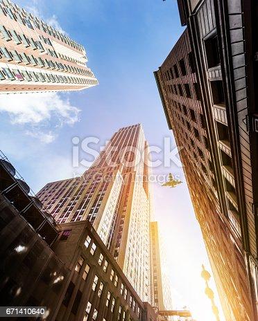 182061540 istock photo Skyscraper with a airplane silhouette 671410640