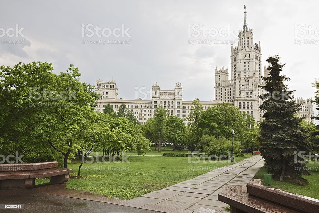 Skyscraper with spring trees in Moscow royalty-free stock photo