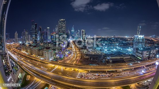 521078742 istock photo Skyscrapers aerial view in downtown and financial district Dubai night timelapse, United Arab Emirates 1235243774