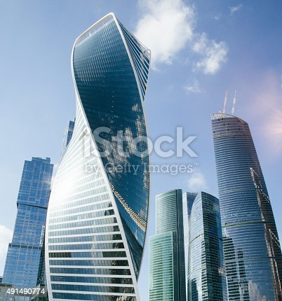istock skyscrapers against a backdrop of blue sky 491490774