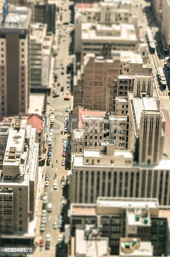 Skyscrapers and everyday people life in the business district of Johannesburg - Aerial view of modern buildings of the skyline in South Africa biggest city - Tilted shift defocusing