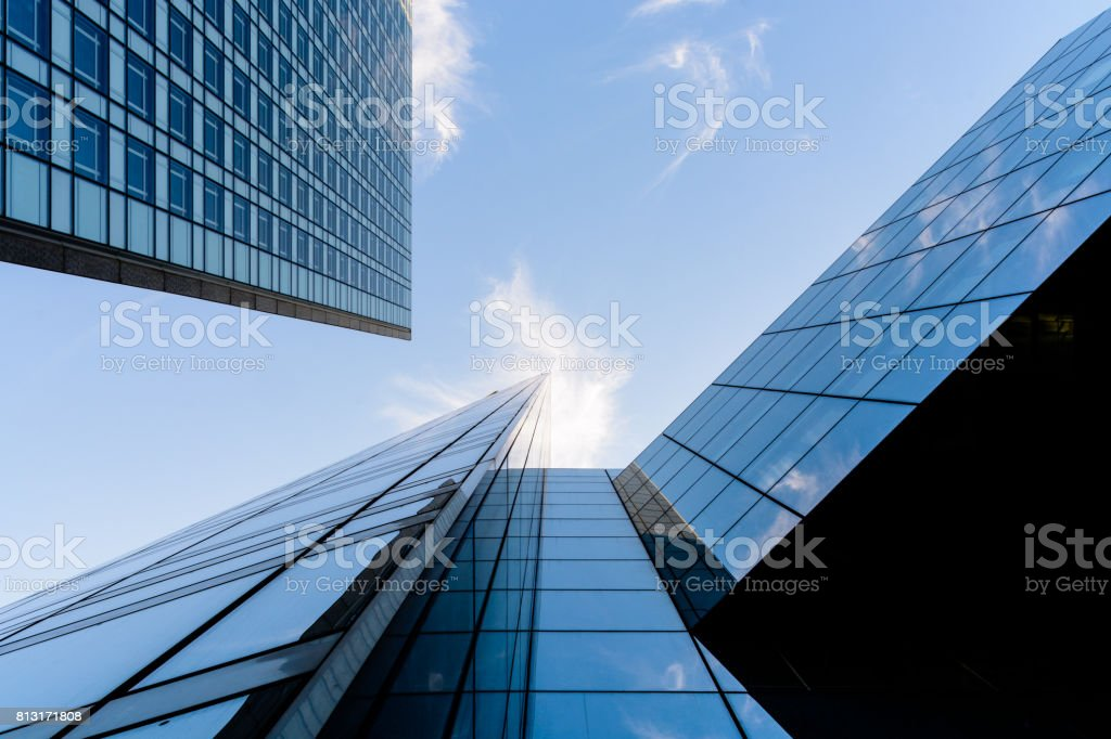 Skyscrapers and glass buildings with blue sky. stock photo