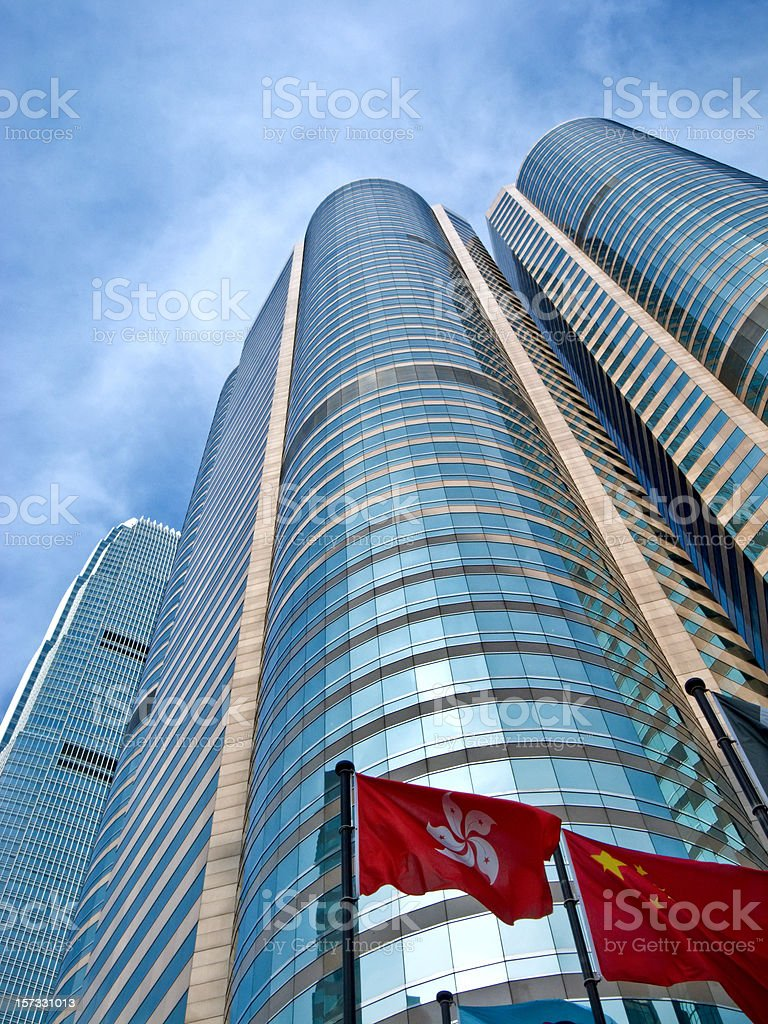 Skyscrapers in Hong Kong financial district behind Chinese and Hong Kong flags stock photo