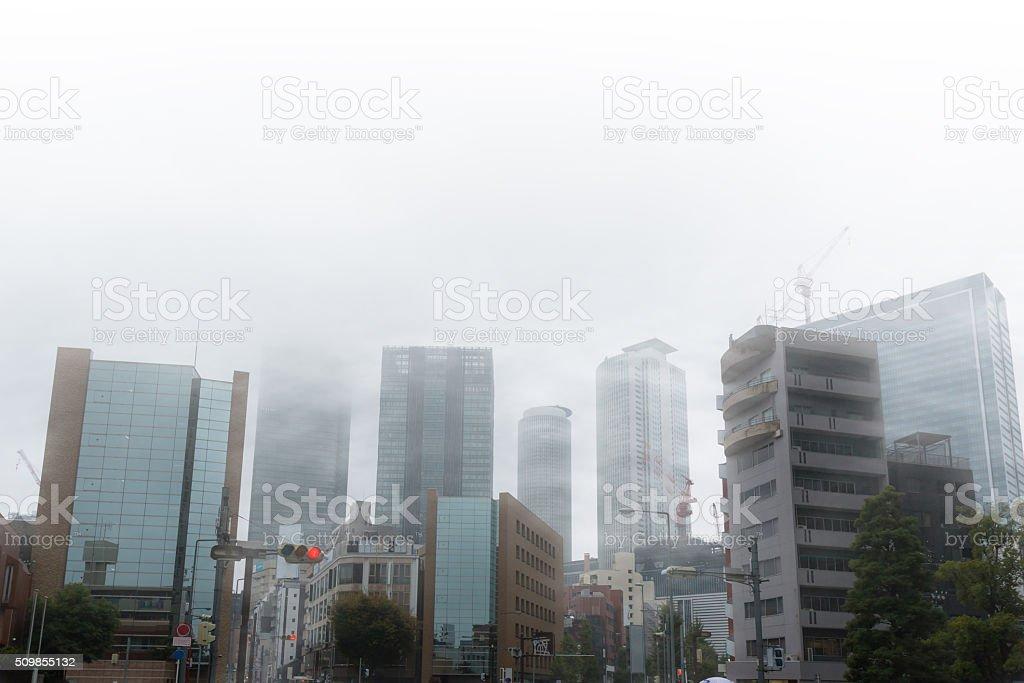 Skyscrapers in mist in nagoya japan. stock photo