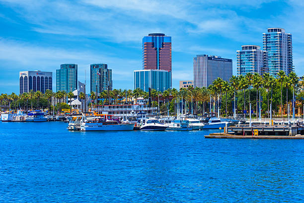 Skyscrapers of Long Beach skyline,harbor,boats,clouds,California Rainbow Harbor at Long Beach Marina with city skyline, California long beach california stock pictures, royalty-free photos & images