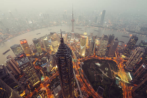 Skyscrapers of Lujiazui in Shanghai, China. Shanghail, China - Oct 13, 2015: Elevated view of Lujiazui district in Shanghai, in Mao Tower in the foreground. Lujiazui has been developed specifically as a new financial district of Shanghai.  bank of china stock pictures, royalty-free photos & images