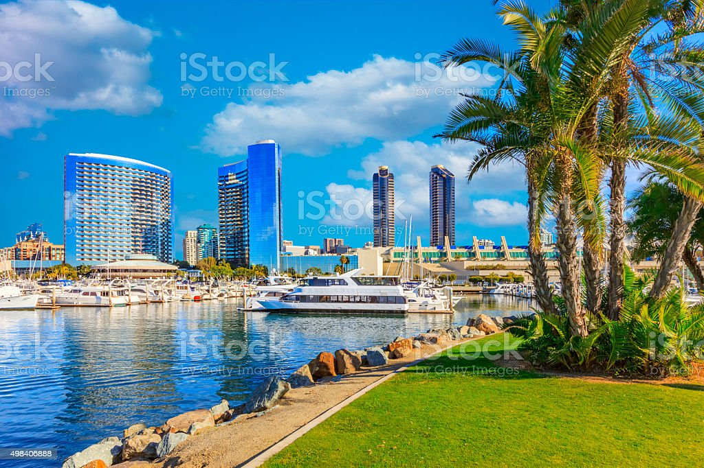 Skyscrapers of San Diego Skyline with reflections and cloudscape stock photo