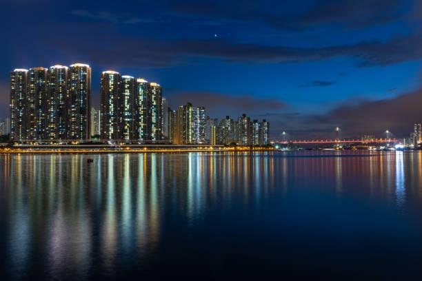 Skyscrapers, reflections and illuminated suspension bridge – zdjęcie