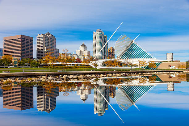 Skyscrapers skyline of Milwaukee and Lake Michigan, WI Skyscrapers skyline of Milwukee and reflections in Lake Michigan, WI milwaukee wisconsin stock pictures, royalty-free photos & images