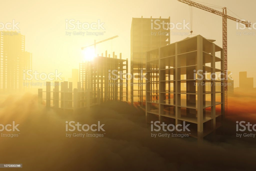 Skyscrapers under construction at sunrise stock photo