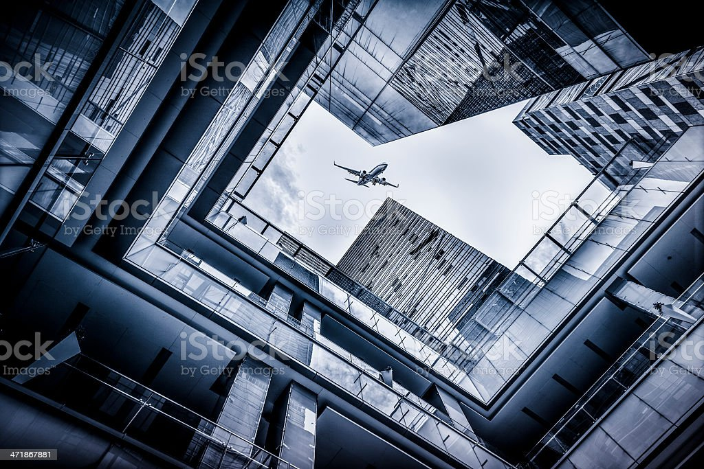 Skyscrapers with airplane royalty-free stock photo