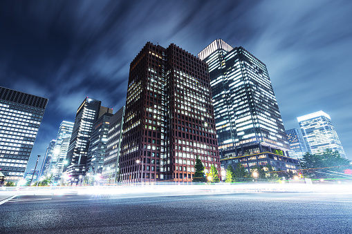 skyscrapers with busy traffic at night in tokyo