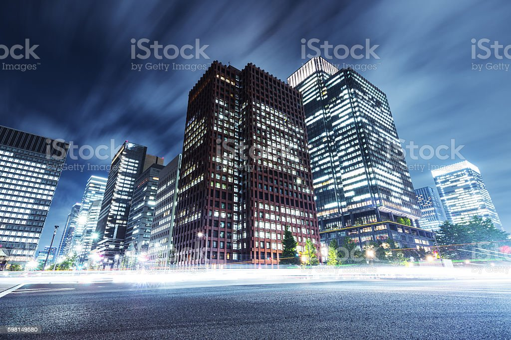 skyscrapers with busy traffic at night stock photo