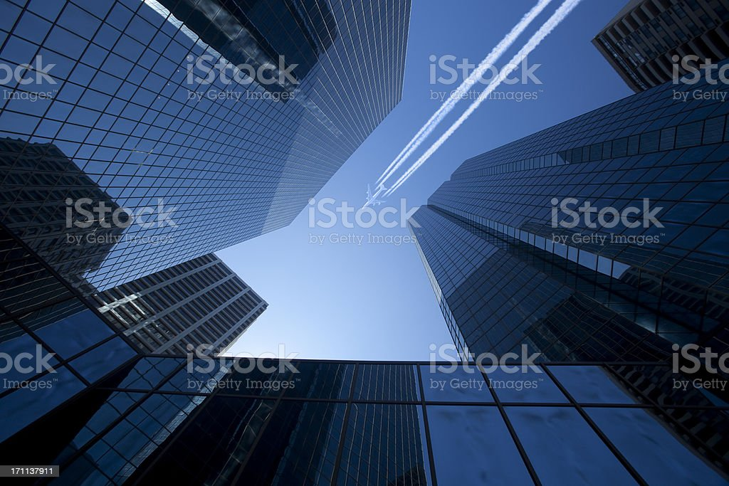 Skyscrapers with Jet stock photo