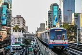 BANGKOK, THAILAND - JAN 5 : BTS Skytrain sits at a city center station, The Thai capital`s public transport rail network has a daily in Bangkok, Thailand