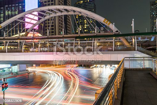Skywalk bridge with car head and rear lights motion with slow speed shutter at intersection