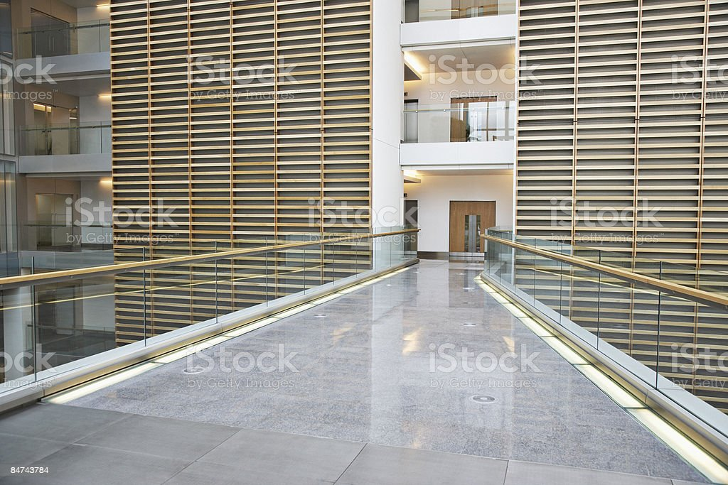 Skywalk in modern office building stock photo