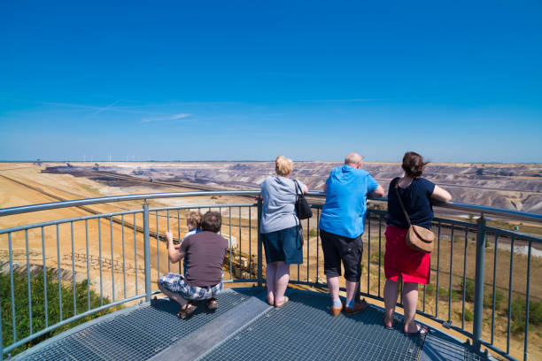 skywalk viewing point over an open surface mine JACKERATH, GERMANY - JULY 7, 2018: Skywalk with unknown people at the Garzweiler open pit brown coal mine tagebau stock pictures, royalty-free photos & images