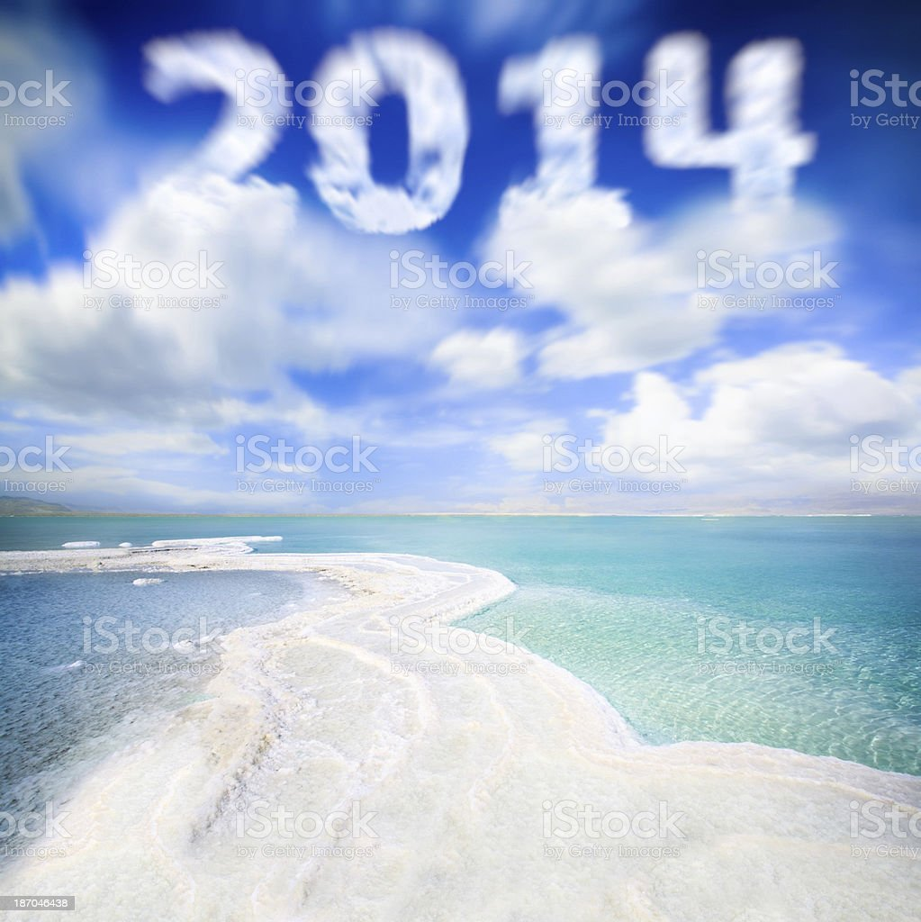 Skywriting with 2014 shape on the sea royalty-free stock photo