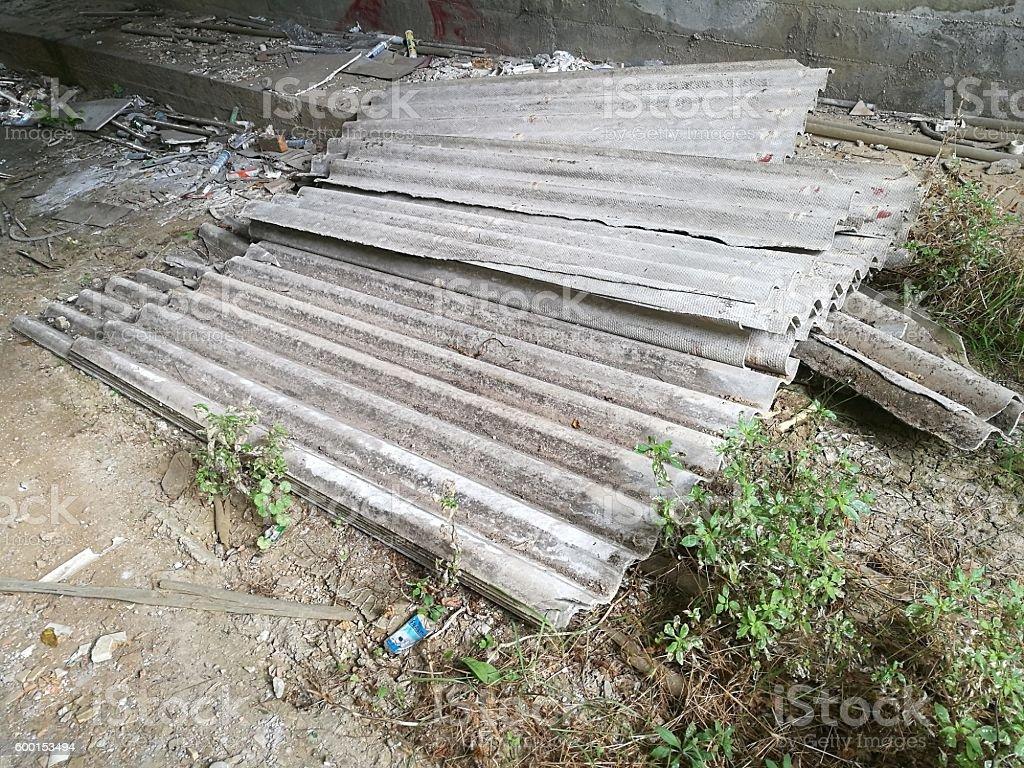 slabs of asbestos abandoned under overpass - foto de acervo