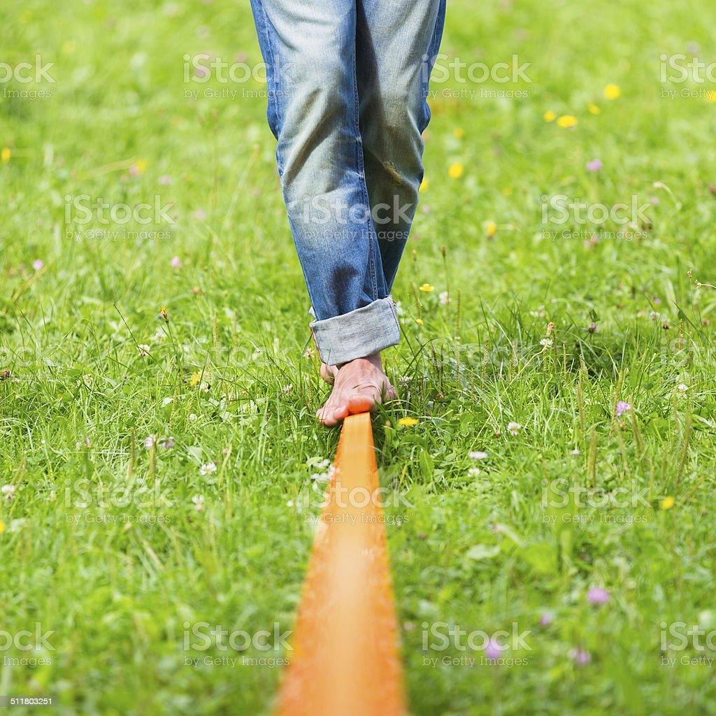 Slack line in the city park. stock photo