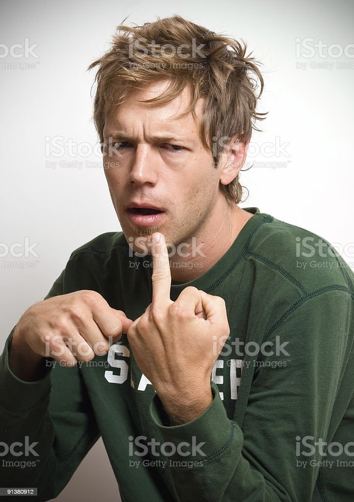 Slacker Guy Portrait Flipping the Bird royalty-free stock photo