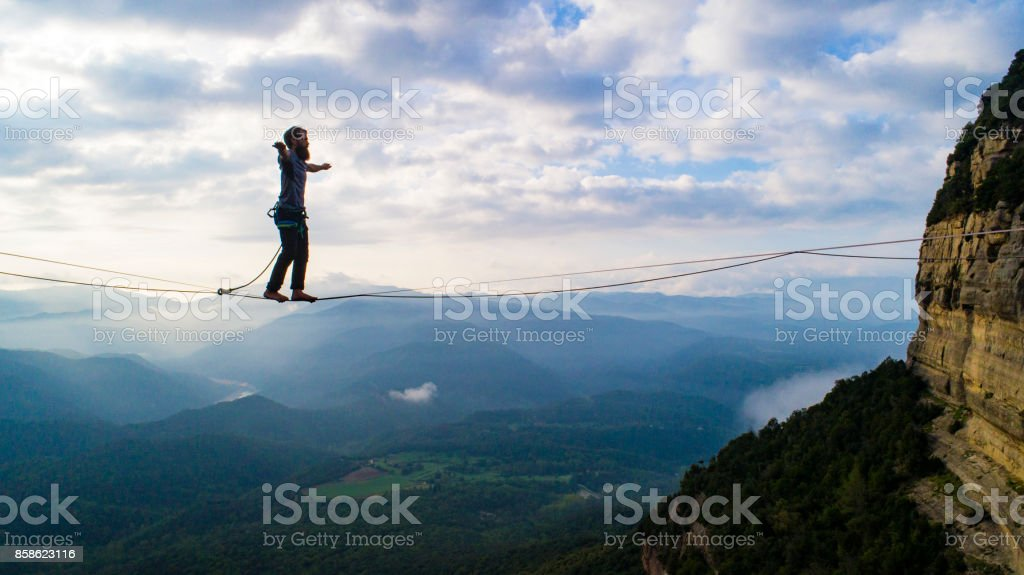 Slacklining in the mountains stock photo