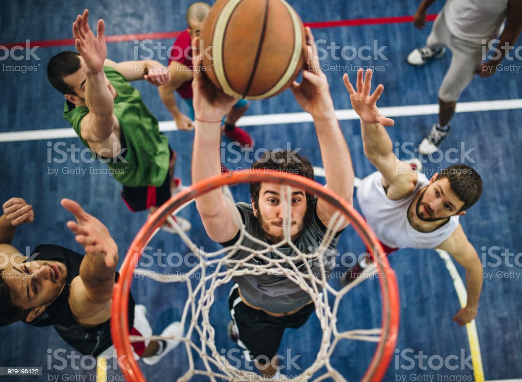 Slam dunk on a basketball court! stock photo