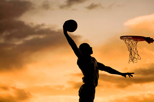 slam dunk shot of basketball player making a slam dunk slam dunk stock pictures, royalty-free photos & images