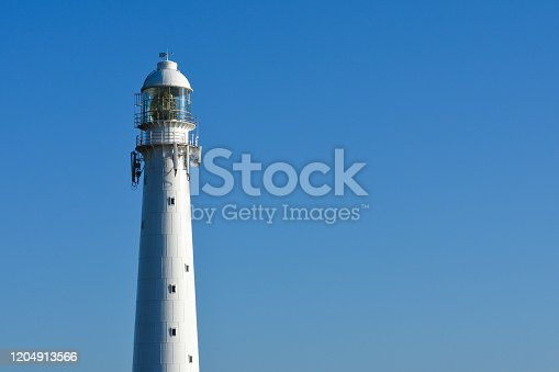 615497916 istock photo Slangkop Lighthouse Tower With Clear Blue Sky 1204913566
