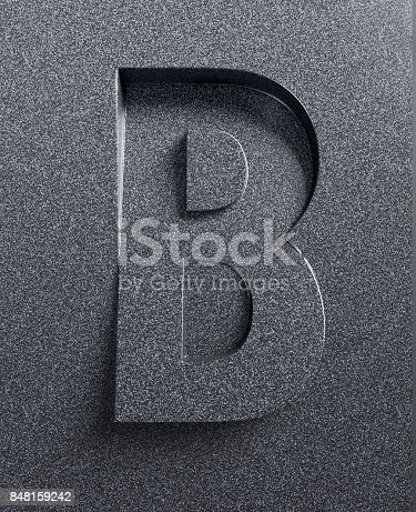 istock Slanted 3d font engraved and extruded from the surface letter B 848159242